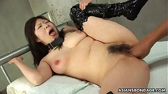 Caged Asian is tortured and fingerfucked